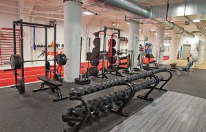 Our strength training area of a fully equipment free weight room with complimentary functional fitness gear.
